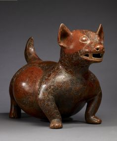 Colima. Mexico.100 BC-AD 300. Dog effigy, earthenware, red slip with black paint.