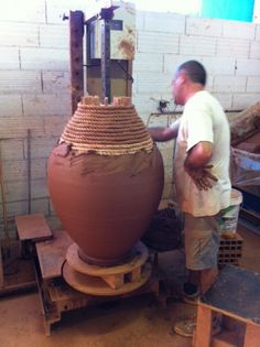 Pretty neat how large garden pots are made in France...