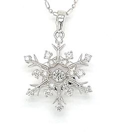 """Celebrate the joy and fun of winter with this precious dancing diamond snowflake pendant. Crafted in your choice of 14K white gold or 14K yellow gold with a center """"dancing"""" round diamond surrounded by additional diamonds accenting each branch and point of the snowflake. Treat yourself or someone you love with this beautifully detailed and brilliant pendant. Gold Jewelry, Fine Jewelry, Snow Flake Tattoo, Teen Fashion, Fashion Outfits, Snowflake Jewelry, Or Rose, Round Diamonds, Snowflakes"""