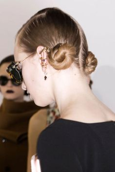 For the hair, Guido Palau divided into two and twisted both sides into perfect, low buns.  Imaxtree