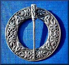 Annular brooch with beautiful entwined foliate decoration typical of the decoration found on Iona medieval grave slabs