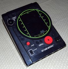 "Vintage Hit and Missile Handheld Electro-Mechanical Game by Tomy, Model No. 7056, Takes 2 ""C"" Batteries, Made in Japan, Copyright 1979."