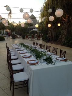 hanging lights over dinner table with White paper lanterns