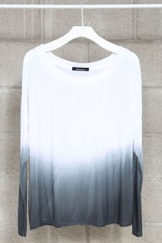 I bought a plain white long sleeve shirt from GAP.  I'm thinking I'm going to ombré it this weekend like this!
