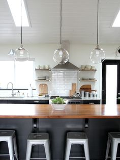 Remodeling Kitchen Lighting Great tips from House Tweaking on how to clean the West Elm globe lights we have in our kitchen. Modern Kitchen Lighting, Kitchen Lighting Fixtures, Kitchen Pendant Lighting, Kitchen Pendants, Home Lighting, Lighting Ideas, Island Pendants, Kitchen Backsplash, Glass Pendants