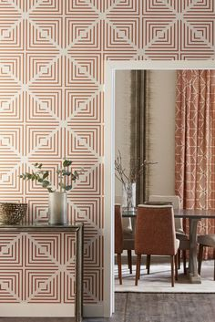 A glamorous, all over, wallpaper design with a repeated geometric diamond motif.