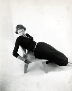 A model, an evocative pose, and an Eames LCW, photographer unknown