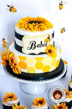 - Have you heard the buzz? There's a babee on the way. :) We had a lot of fun creating this bee/sunflower themed baby shower cake to fit their decorations. The last 2 pictures a courtesy Allana who commissioned the cake. For more pictures please. Sunflower Party, Sunflower Cakes, Sunflower Baby Showers, Sunflower Birthday Parties, Bee Cakes, Cupcake Cakes, Bolo Halloween, Baby Shower Gender Reveal, Baby Shower Cakes Neutral