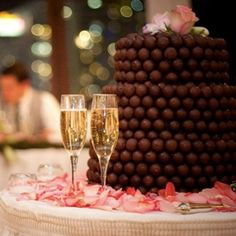 Creative idea for wedding cake using gourmet chocolate candy.  See more candy wedding favors and party ideas at www.one-stop-party-ideas.com