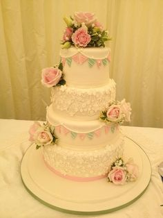 The Cake Wizards @kellyemmaellis  Wedding cake for my best buddy! All flowers and bunting!
