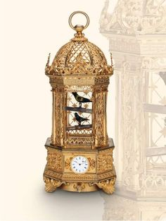 Fine and rare gilt bronze singing bird cage with two birds and watch. Attributed to Charles Abraham Bruguier, Geneva, circa 1840.