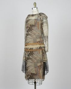 "Woman's Dress H.R. Mallinson & Co., manufacturer American, 1915-1937 Walter Mitschke, designer German; American, 1881-1962 Woman's Dress, ""Sioux War Bonnet"" print from the American Indian Series, ca. 1928 Screenprinted silk 2006.6"