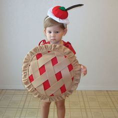 Halloween Costume Ideas - 8 Adorable Pictures Of Babies Dressed As Food For Halloween. Let's face it —the best part about Halloween costumes is getting to dress up your little one. No ingredients necessary for this cherry pie, just a cutie to wear it. Check out some of the cutest baby costumes out there at redbookmag.com.