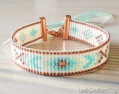 Handmade woven bracelet with high quality Miyuki delicas glass beads in the colors white (pearl), silver, mint / aqua and pink. At the end of the extension chain is a heart charm attached. Fresh summery colors!  By the extension chain the bracelet is suitable for wrist sizes 16,5 - 21,5 cm (6.5 - 8.5 inches).  Also great as a gift!  The listing is for one bracelet (the one on the first 3 photos).  After confirmation of your order the bracelet will be sent within 1-2 working days.   For m...
