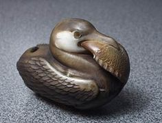 "Ukai - netsuke - cormorant swallowing a fish, by Sergey Osipov. Carved tagua nut (""vegetable ivory"")"