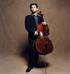The gorgeous cellist Gautier Capucon, who may or may not be the wallpaper on my phone. Not only is he gorgeous, he plays beautifully and has a beautiful cello. I'm not sure what I like the most.   The world needs more hot cellists. One can never have too many.