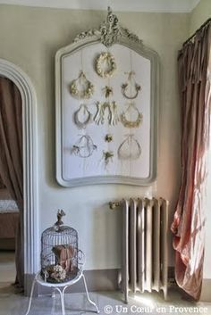 jewelry display idea - turn old mirror into a bulletin board and use to pin items up