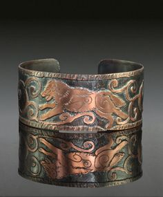 Running Wolf Etched Copper Cuff Bracelet. by LunariaJewellery