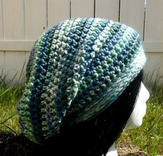 Miss Pond. This variegated slouch hat has shades of green and blue. It weight is light making it perfect for all year. Available to order @ facebook.com/hooka.yarn
