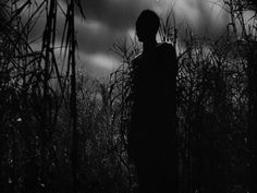A zombie sentry stands guard over a voodoo ritual in Val Lewton's creepy and atmospheric I Walked With a Zombie (1943)