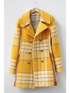 This is The cutest yellow coat. Love the color and the print and the buttons