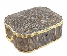 """ENGLISH COLONIAL SILVER AND SILVER FILIGREE BOX circa 1935 of scalloped rectangular form with hinged cover and flanked by handles, the top and sides overlaid with filigree work. Engraved on the underside, """"B.W. & A.W. 1885-1935."""