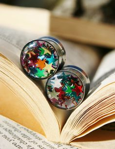 . I WANT THESE! Star Glitter Plugs in Resin for gauged ears by PluggingAlong, $28.00