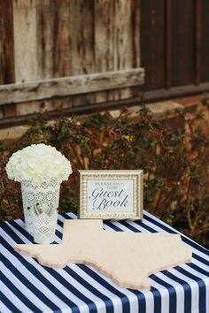 state-shaped wooden guest book for guests to sign - we love this idea! | Sara & Rocky #wedding