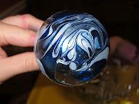 Swirled ornaments - glass balls dipped in water with nail polish!