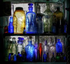 backlit bottles in window