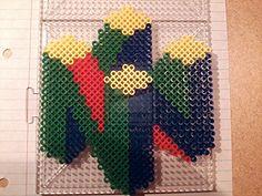 Nintendo 64 Logo perler beads by PerlerPixie on deviantART Hama Beads Patterns, Beading Patterns, Nintendo 64, Diy Perler Beads, Pixel Pattern, Minecraft Pixel Art, Alpha Patterns, Fuse Beads, Bead Art