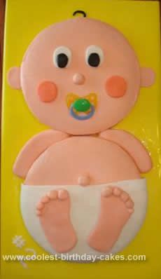 Homemade Boy or Girl Baby Shower Cake: My friend was having her second baby and we did not know boy or girl. I used two round cakes for the head and body. I iced each cake and let it sit for