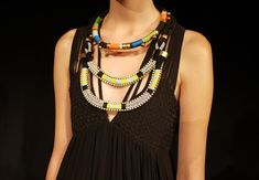 mara hoffman, love her stuff!   and it mustn't be that difficult to diy those necklaces....