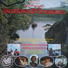 The vinyl LP that accompanied the film 'Swallows & Amazons' narrated by David Wood the screenwriter with a full music score by the composer Wilfred Josephs. the front cover includes phtographs of Virginia McKenna, Sophie Neville, Simon West, Suzanna Hamilton, Sten Grendon and Ronald Fraser on location in the Lake District where the original book by Arthur Ransome was written.