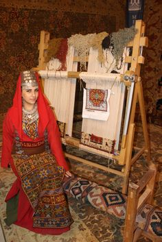 Armenian girl with traditional costumes in front of the  loom at Megerian  Carpet  Company.