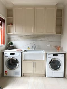 Traditional Laundry featuring Polytec Ballarat profiled doors 2-PAC painted. Quantum quartz Carrara quartz stone benchtops with quantum six+ Calcutta honed porcelain splashback.