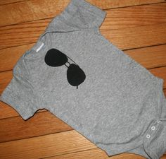 top gun onesie - print an image of aviators onto an iron transfer sheet. put on a onesie.