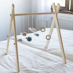 This simple wooden play mobile won't cost much to make and you can add colourful or interesting shapes, homemade toys or eye-catching items to keep your little one occupied. Diy Baby Gym, Diy Bebe, Painted Rocks Kids, Pregnancy Gifts, Musical Toys, Homemade Toys, Bath Toys, Natural Baby, Toddler Toys