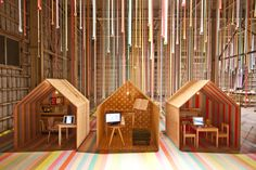 Tape installation and plywood doll houses. awesome simple design for a pop up store, by iyamadesign inc.
