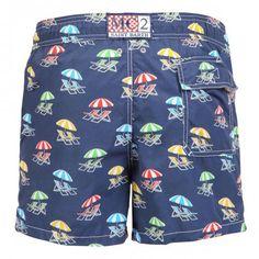 NYLON MID-LENGTH SLIM-LINE CUT SWIM SHORTS WITH BEACH UMBRELLA PRINT PATTERN - Nylon mid-length slim-line cut Swim Shorts with multi-color beach umbrella and beach chairs print. Two front pockets and back Velcro pocket. Fabric MC2 brand patch on waist to the reverse. Internal net. Elastic waistband with adjustable drawstring.  #mrbeachwear #mc2 #boardshort #fashion #man #summer #style