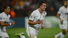 Robin van Persie celebrates his second goal of the match for Manchester United vs Cluj in a 2012-13 UEFA Champions League group stage match.  Manchester United eventually won the game 2-0.