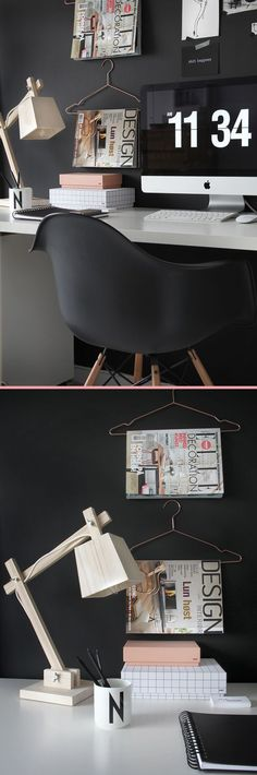 Against a black wall, with black Eames chair & wood accents. Design studio, workspace.