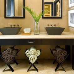 Bathroom Towel Storage Ideas: Turn the open area below a modern sink into useful storage space. To create storage, roll up towels and place them in contemporary wooden magazine racks. by SAburns Bathroom Hand Towel Holder, Bathroom Towel Storage, Bathroom Towels, Bathroom Storage, Bathroom Organization, Bathroom Rack, Ikea Bathroom, Vanity Bathroom, Bathroom Small