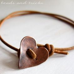 Copper heart button as a fastener on a leather bracelet--simple perfection