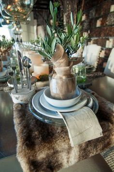 Pottery Barn- winter party-note: slice of birch branch with pre-drilled holes for flatware.