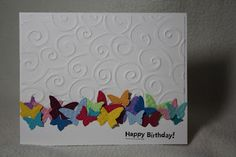 The beautiful butterflies are made with the Sizzlit and the butterfly punch.  The background is an embossing folder.