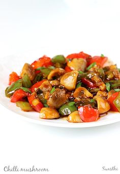 Chilli mushroom stir fry recipe - a recipe without deep frying mushrooms. It tastes great, can be served as a appetizer with hakka noodles or fried rice