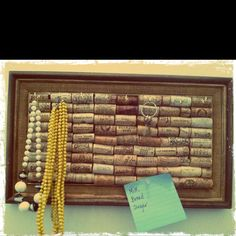 Vintage frame cork board made with wine corks can be used to hang necklaces, keys or to tack reminder notes.