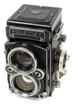 The Rollei Rolleiflex 2.8 E3 is the Caddilac of Twin Lens Reflex cameras. The chassis is spectacularly designed and the Zeiss Planar 80mm f/2.8 lens is sharp as a tack (or pin). This one was found covered in grime in a basement (oh the humanity!)