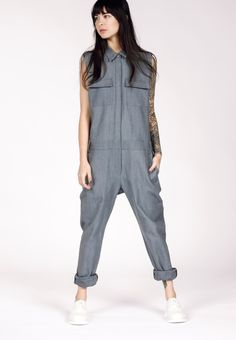 This workwear-inspired tomboy staple is constructed in soft but sturdy denim. We love the hidden button placket which gives these coveralls a contemporary touch. By Wildfang.